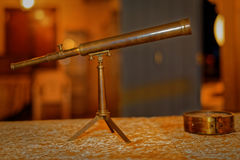 Antique telescope. Antique Arabic telescope with blurred background Stock Photos
