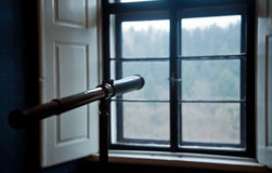 An antique telescope in front of window. An antique telescope in front of window Royalty Free Stock Image