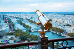 Antique telescope with view over Paris. France, at dusk Stock Images