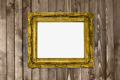 Antique texture gold frame hanging wood wal Royalty Free Stock Photo