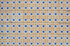 Antique Textured Portuguese Tiles. Vintage portuguese textured blue and yellow tiles on an exterior wall on Figueira da Foz, Portugal stock photos