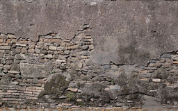 Antique textured wall from stone in Rome Stock Photo