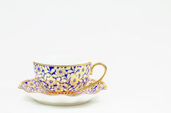 Antique Thai ceramic coffee cup with saucer on white background Royalty Free Stock Photo