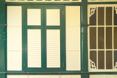 Antique Thai style green frame yellow window Stock Images
