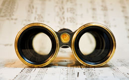 Antique theater binoculars over classical music Stock Images