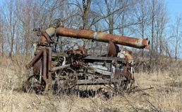 Antique threshing machine rusting in the weeds Stock Photos