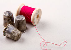 Antique thread and thimbles Royalty Free Stock Photos