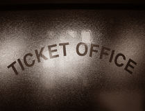 Antique Ticket Office Window Sign. Antique ticket office lettering sign on a privacy glass window at a railroad station sales counter in nostalgic sepia Royalty Free Stock Photos