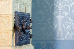 Antique tile stove Stock Photos