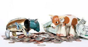 Bear Versus Bull Financial Market. An antique tin bear and toy bull speculate about global financial markets Royalty Free Stock Photo