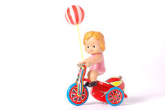 Antique tin toy. Girl riding bike Stock Images