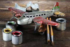 Antique tin toy plane. Restoration of an antique tin toy plane Royalty Free Stock Photography