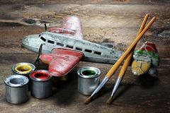 Antique tin toy plane. Restoration of an antique tin toy plane Royalty Free Stock Images