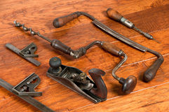 Antique tools in arrangement on wood background Royalty Free Stock Photography