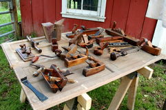 Antique Tools on Bench. Antique tools on table in front of old work shed stock image