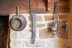 Antique tools in country kitchen. A collection of old antique tools hung in a country kitchen Stock Image
