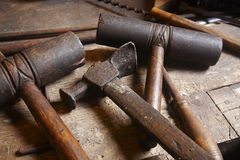 Antique tools. Hammers with wood pieces. Royalty Free Stock Photos