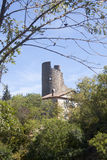 Antique tower made of stone surrounded of trees in Lagrasse Royalty Free Stock Photos