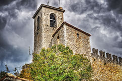 Antique tower in San Marino under an overcast sky Stock Photography