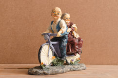 Antique Toy bike. Grandfather and grandmother Stock Image