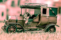 Antique Toy Car. Vintage style Royalty Free Stock Photography