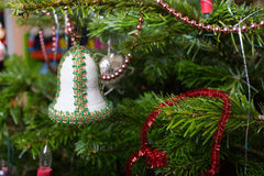 Antique toy on Christmas tree. Royalty Free Stock Image