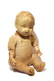 Antique Toy Doll. Isolated antique play doll toy starting to fall apart Stock Photography