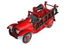 Antique Toy Fire Engine. Isolated on a white background Royalty Free Stock Images