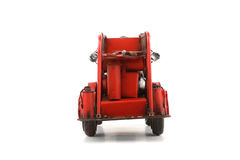 Antique Toy Fire Engine on white background, isolated Royalty Free Stock Image