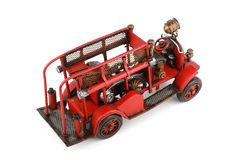 Antique Toy Fire Engine on white background, isolated Royalty Free Stock Photos