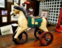 Antique toy horse. On wheels Stock Photos