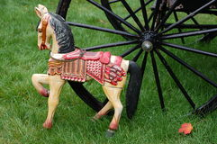 Antique toy horse. Vintage wheels from carriage Royalty Free Stock Images