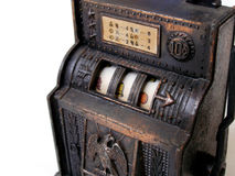 Antique toy slot machine. An antique slot machine with copper metal colour casing.  Quaint and rustic looking jackpot Stock Image