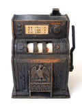 Antique toy slot machine. Try your luck! - An antique slot machine with copper metal colour casing.  Quaint and rustic looking jackpot. Replica of toy is Royalty Free Stock Photo