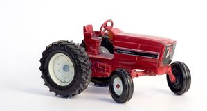 Antique Toy Tractor. An old red metal toy tractor Royalty Free Stock Photos