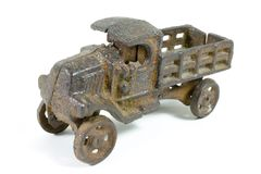 Antique toy truck. Metal antique toy truck, heavily rusted and worn Royalty Free Stock Photos