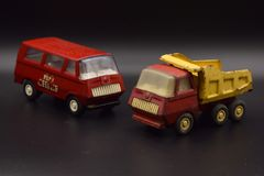 Antique Toy Trucks on Black stock photos