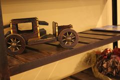 Antique toy in wood toy car stock photography