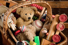 Antique toys. Old basket filled with antique wooden toys Royalty Free Stock Photos