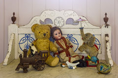 Antique toys. Vintage old toys including doll, teddy bear, train and elephant Royalty Free Stock Photo