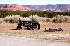 Antique tractor. Sits in the desert Stock Image