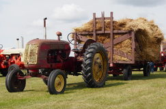 Antique Tractor With Hay Wagon Loaded With Hay Stock Photos