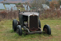 Antique Tractor and Modern Solar Panels. The old and new captured in this photo of old rusty tractor with solar farm behind it royalty free stock photos