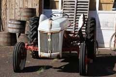 Antique Tractor. This antique tractor probably has not been used in many years. It looks like it was originally orange and someone slapped a coat of white paint Royalty Free Stock Images