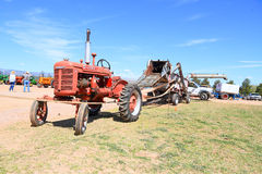 Antique Farmall Tractor Pulling & Powering Combine Harvester Royalty Free Stock Photography
