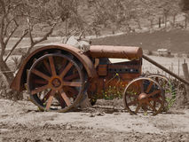 Antique tractor on Sepia Stock Images