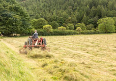 Antique tractor and threshing machine Stock Images