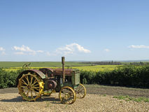 Antique tractor with view. Stock Photos