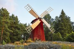 Antique traditional wooden windmill in Finland. Picturesque finn. Ish countryside. Horizontal Stock Photography