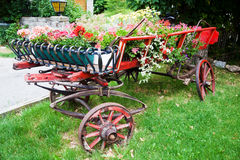 Antique trailer with flower decoration Royalty Free Stock Images